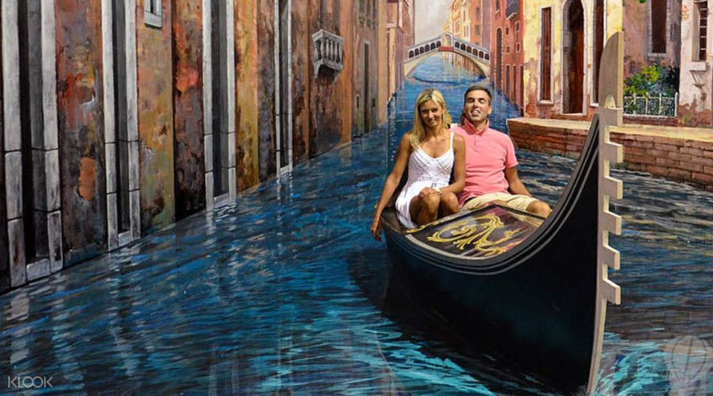 Man and woman on gondola ride in the art of paradise, pattaya.